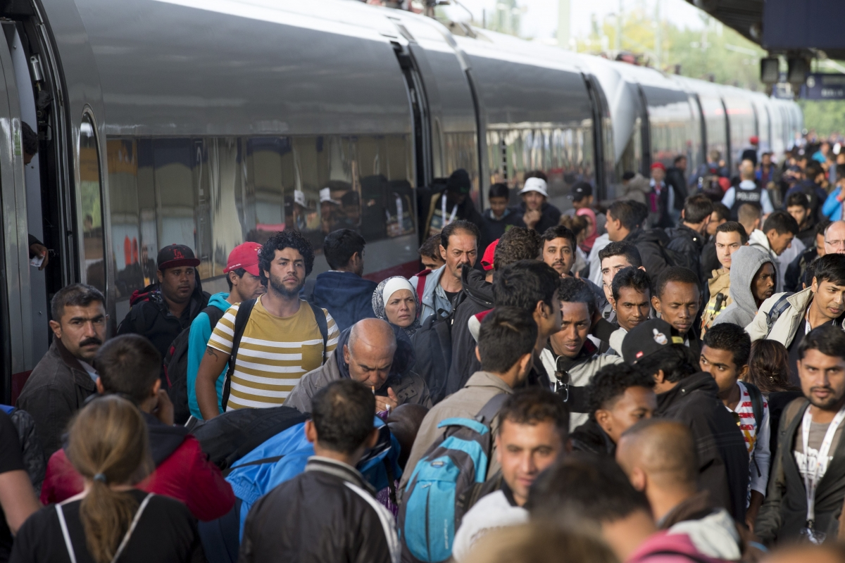 Refugees and immigrants arrive at Munich train
