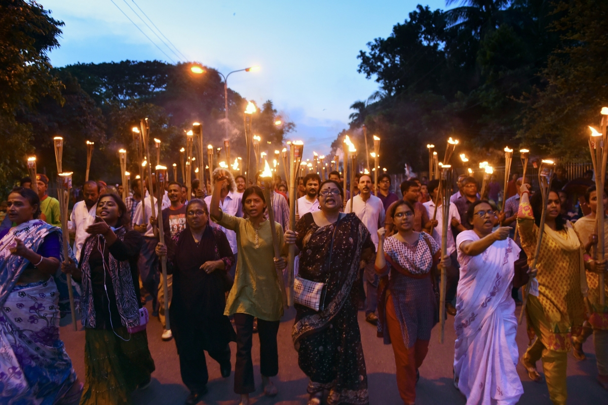 Bangladeshi secular activists take part in a torch-lit protest against the killing of blogger Niloy Chakrabarti, who used the pen-name Niloy Neel, in Dhaka on August