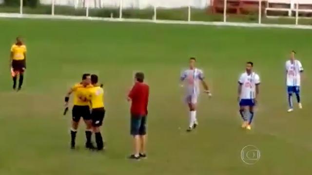 Referee pulls a gun