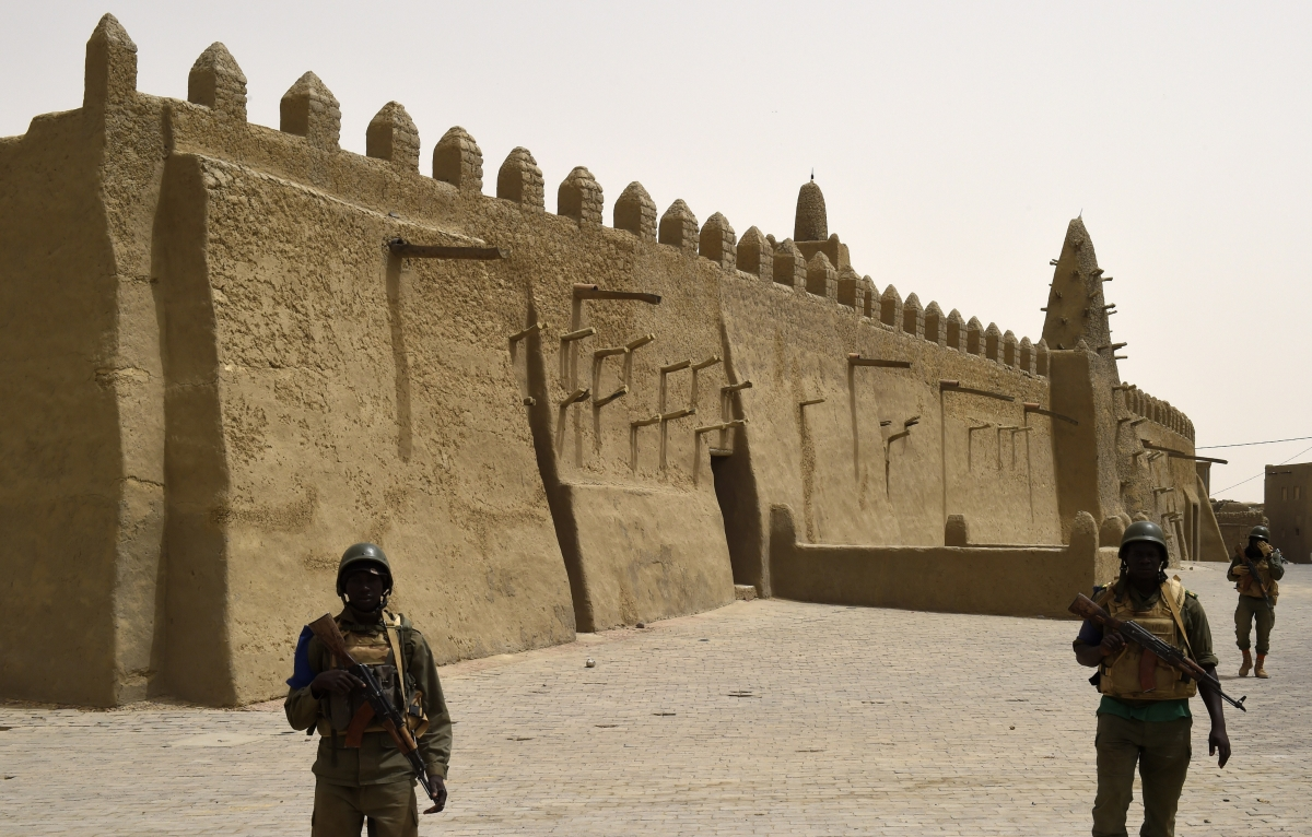 Malian soldiers patrol the ancient city of