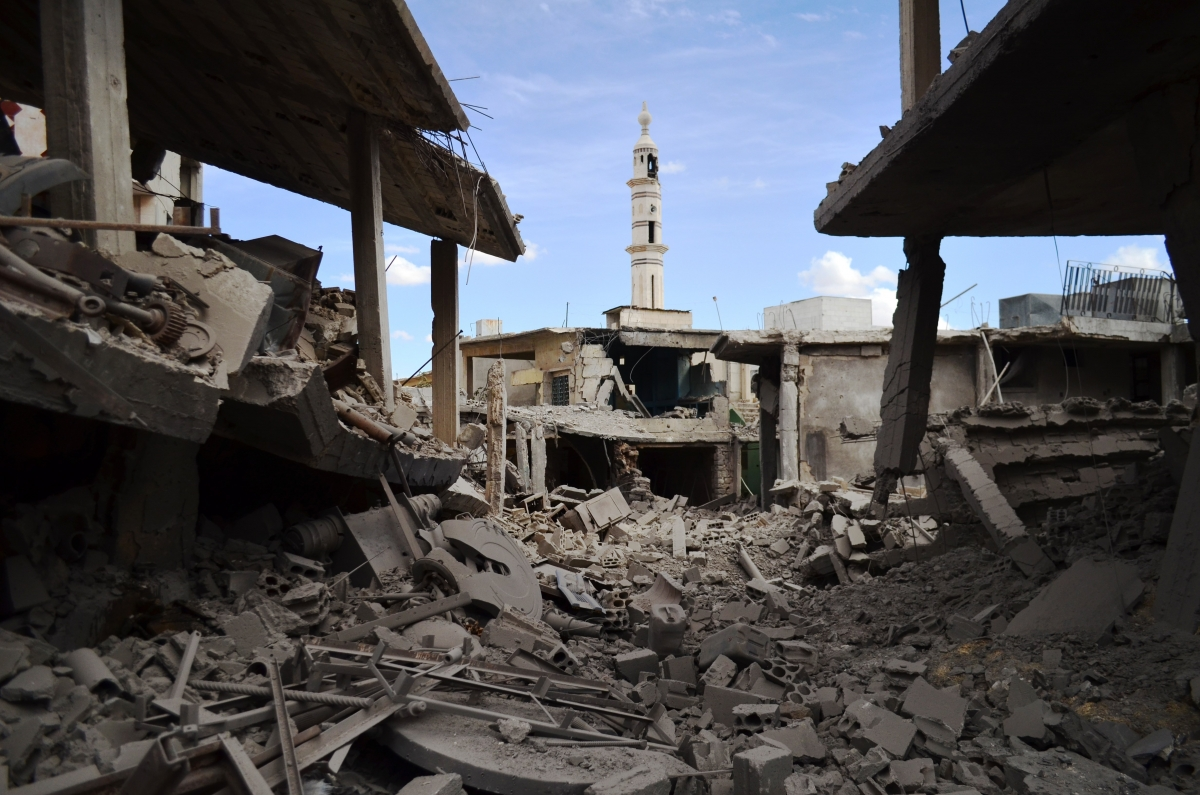 damaged buildings and a minaret in the central Syrian town of Talbisseh in the Homs province