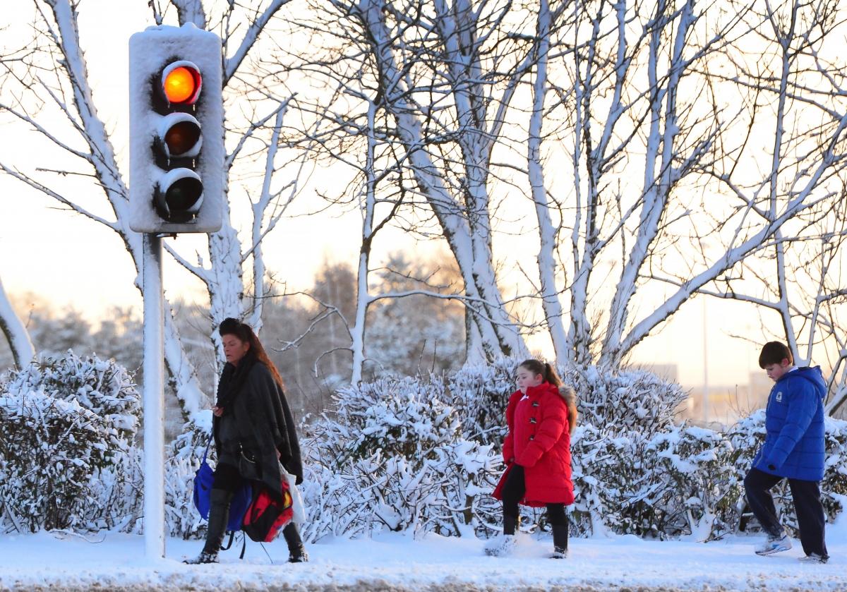 People walk in snow in the UK