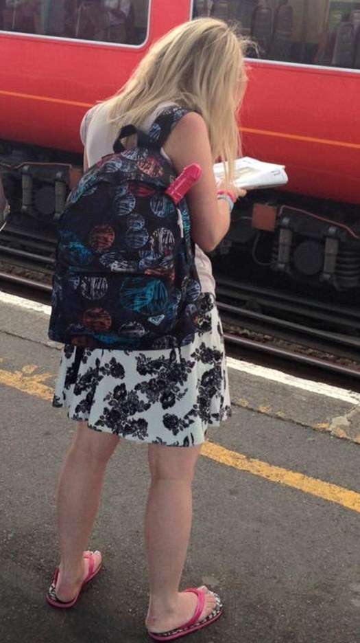 Dildo poking out of woman's bag