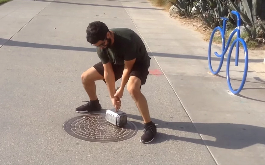 Man tries to lift Thor hammer replica