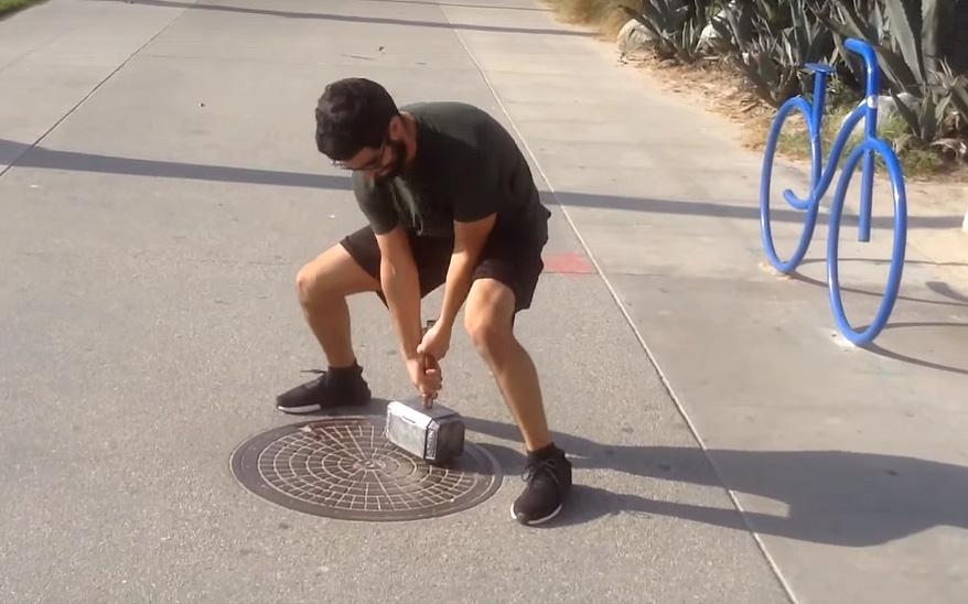 Man tries to lift Thor hammer replica