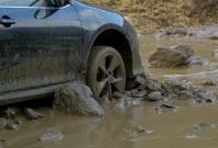 Cars stuck in mud