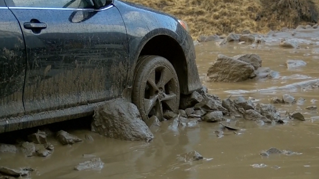 Cars stuck in mud