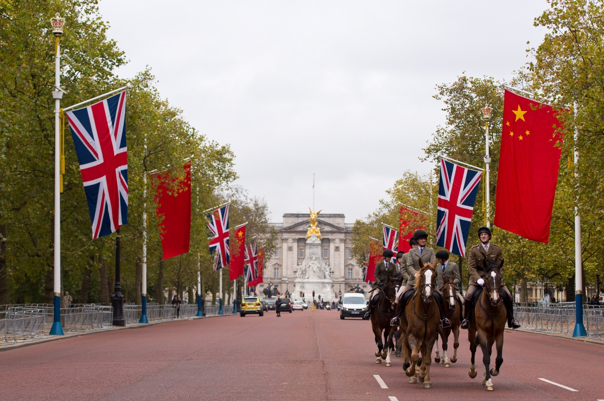 Horses ride down The Mall