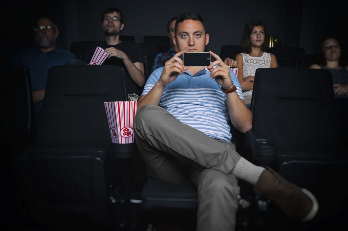 Man illegally recording in a movie screening
