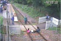 Matlock Bath - Children sit on rails while mother takes picture