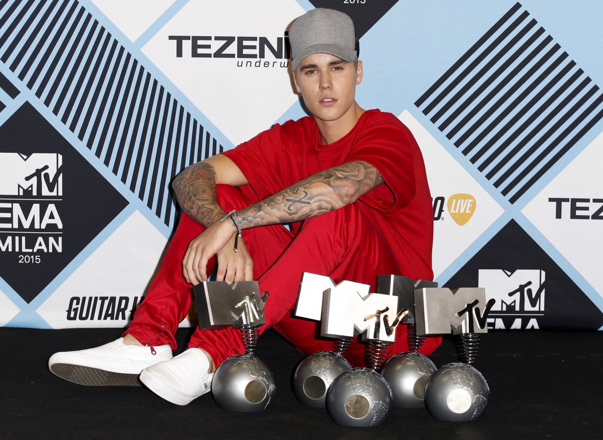 Justin Bieber with his awards