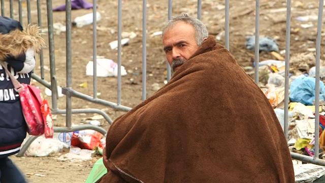 A refugee waits