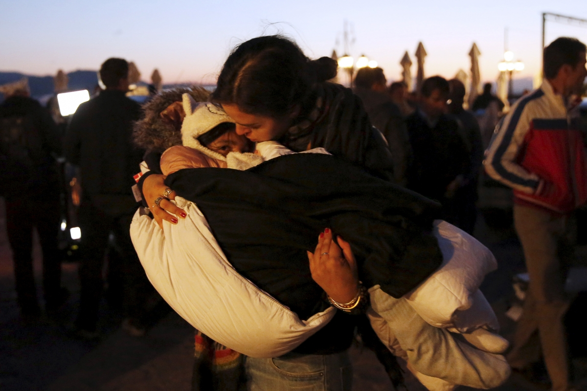 Lesbos volunteer cradles child