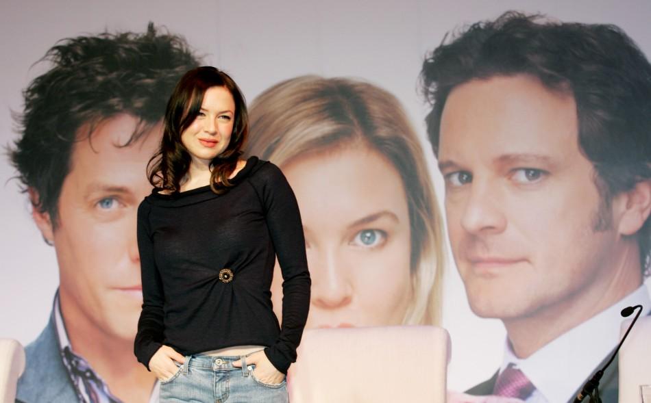 Renee Zellweger poses in front of a poster for 'Bridget Jones - The Edge of Reason'