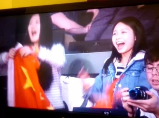 Chinese fans cheer during World Gymnastics Championships