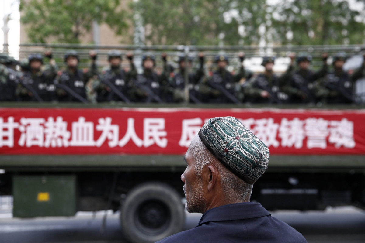 Uighur man looks on