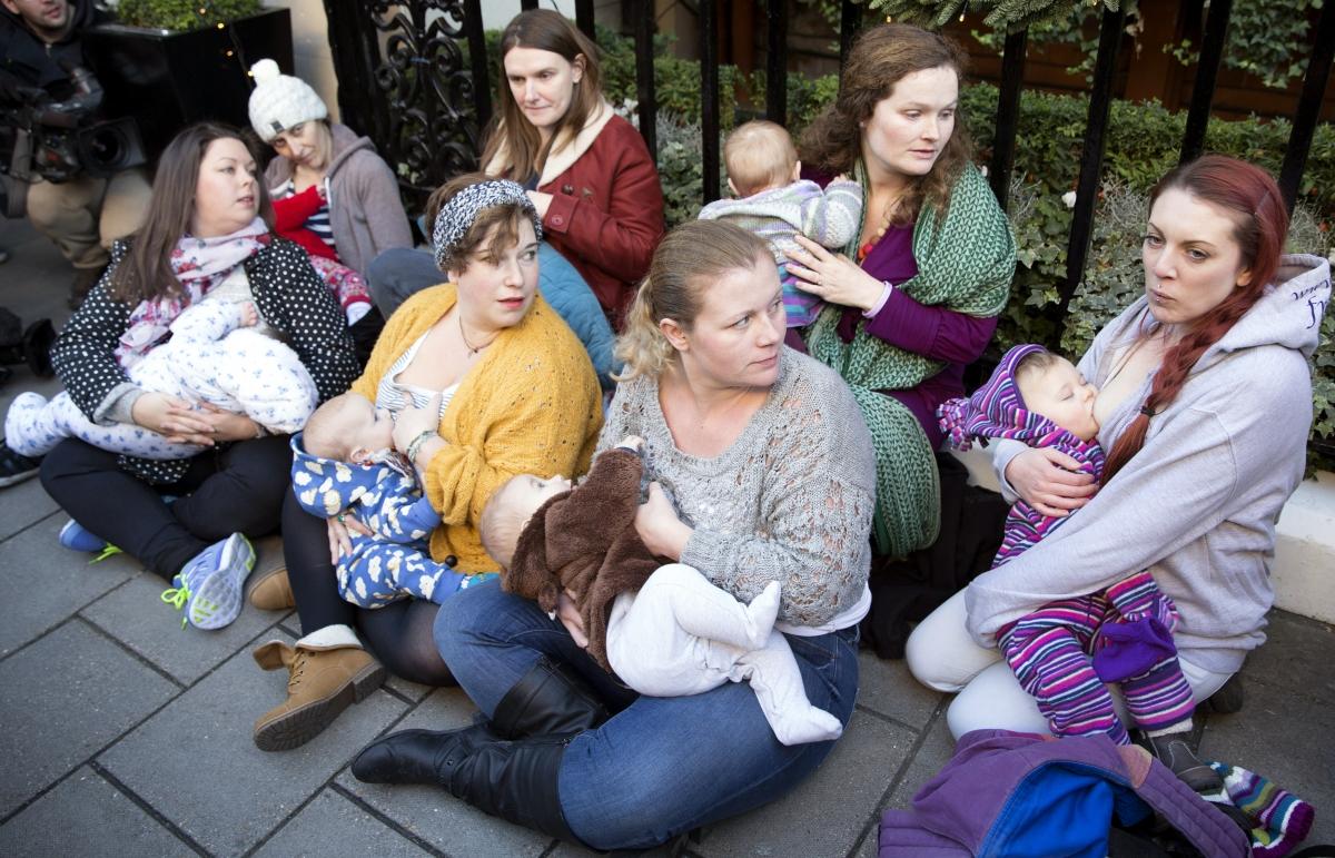 Women breastfeed outside Claridge's hotel in London