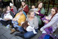 Women breastfeed outside Claridge\'s hotel in London