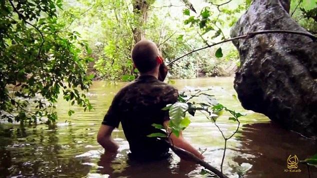 Jihadi wades through swamp