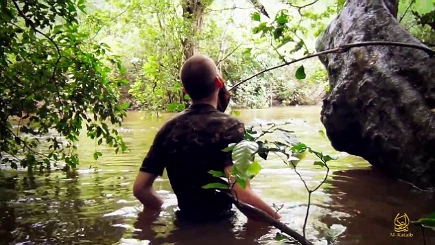 Jihadi wades through swamp