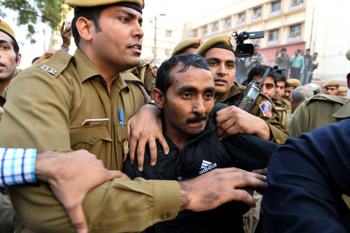 Indian Uber rapist escorted by police