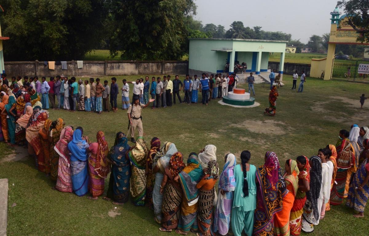 Indian voters queue to vote in Bihar