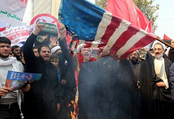 Iran burns U.S. flags