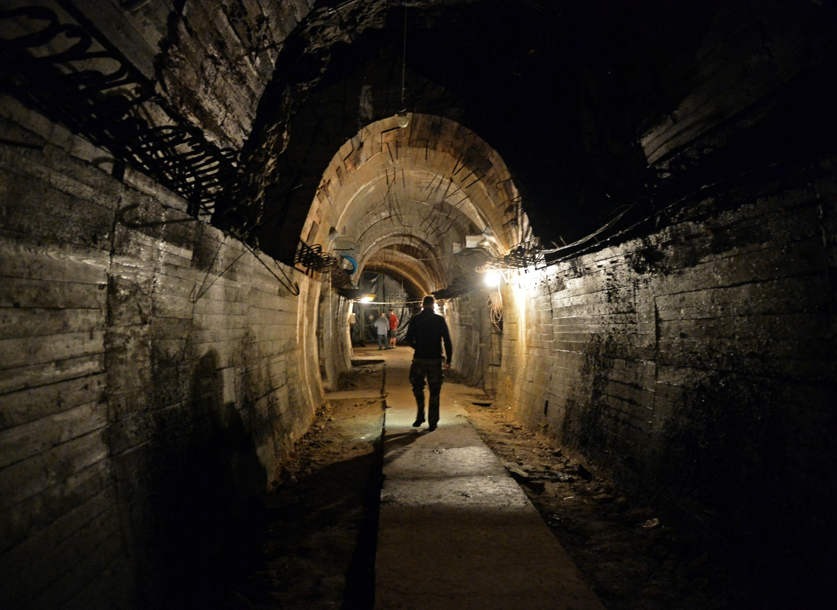 Men walk in underground galleries, part of Nazi Germany 'Riese' construction project under the Ksiaz castle in the area where the 'Nazi gold train' is supposedly hidden underground