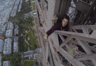Kingston free-climbs the Eiffel Tower