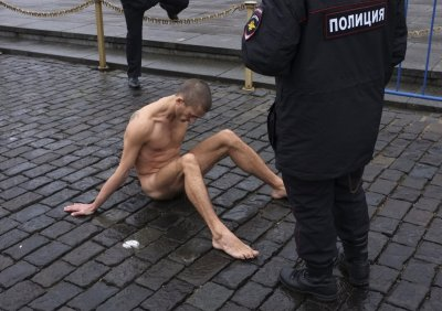 Pyotr Pavlensky nailed himself to the cobblestonesonRussia