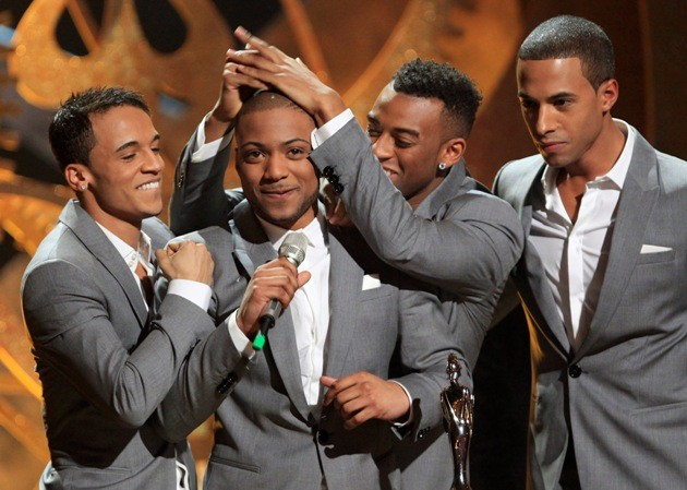 British band JLS accept the award for British single at the 30th Brit Awards ceremony in London