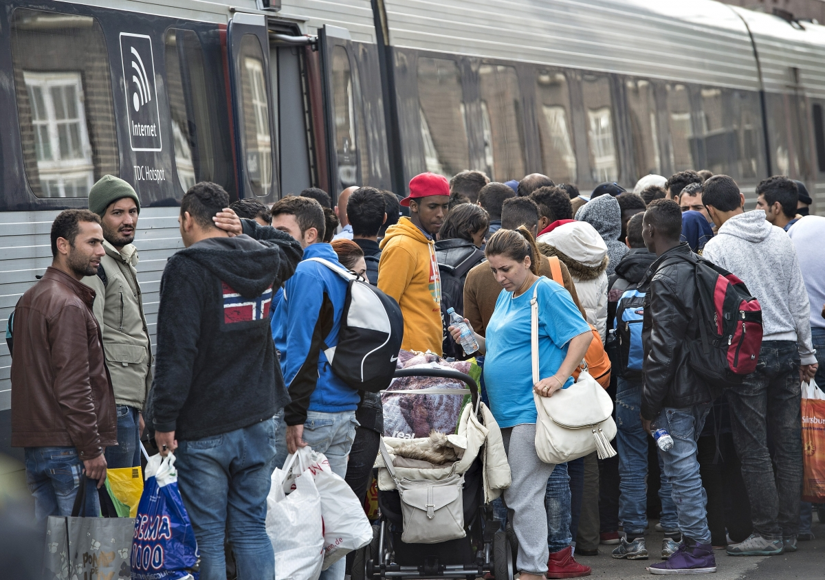 Immigrants board a train bound for Sweden
