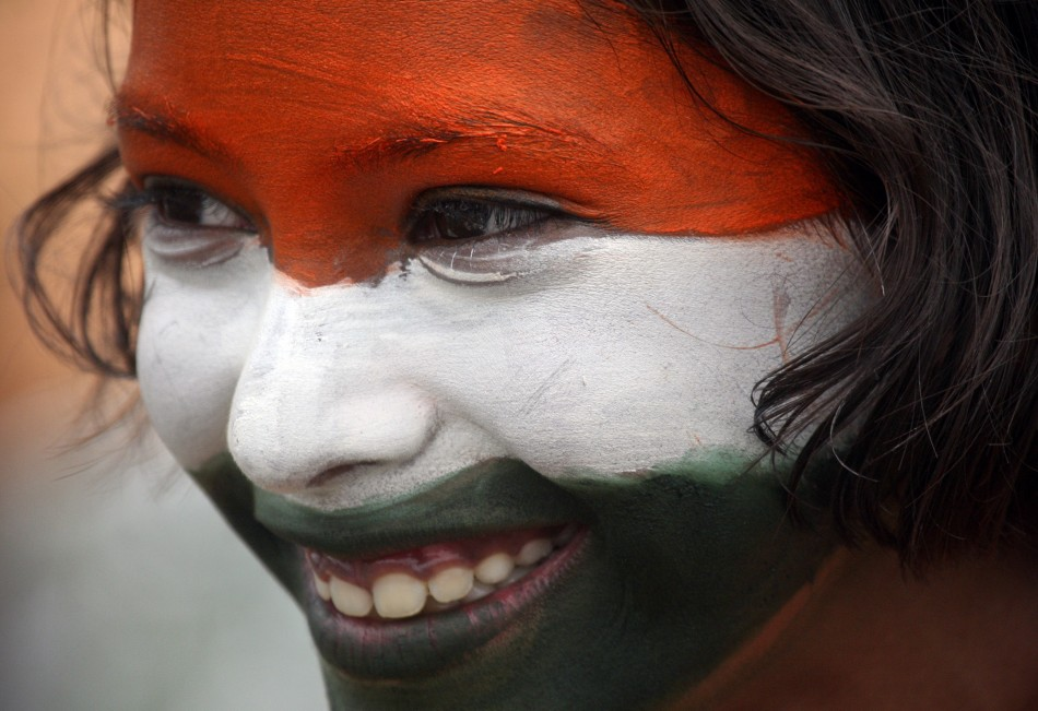 A school girl takes part in a cultural program to celebrate India's Independence Day in the northern Indian city of Chandigarh