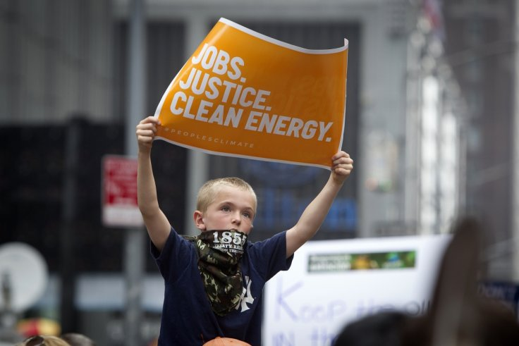 child holds protest sign