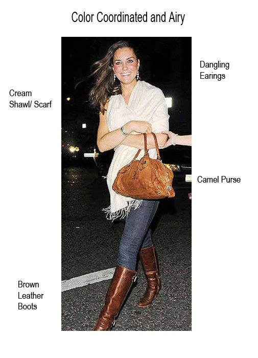 Kate Middleton wearing a cream shawl over jeans and brown boots.