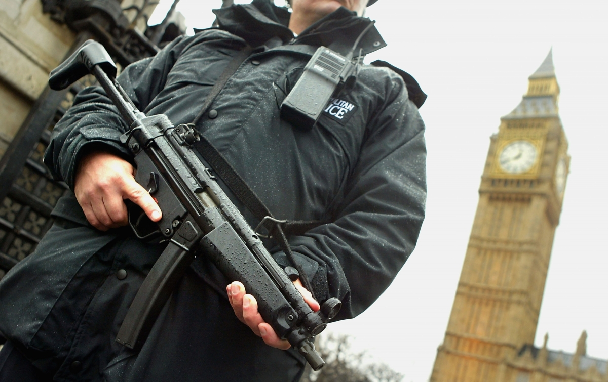 Police with gun in London