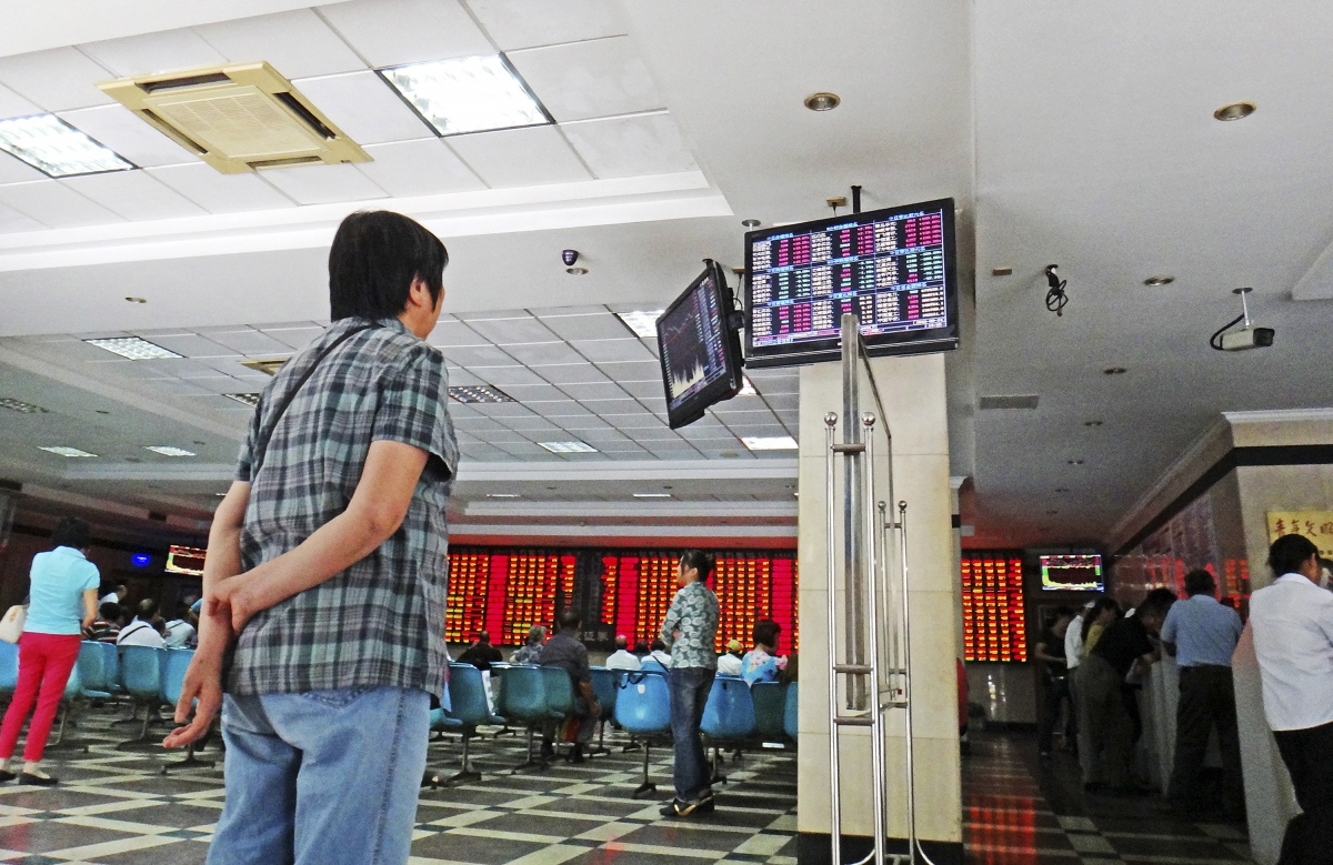 Asian markets mixed as investors await clarity on global monetary policies; Oil prices slip