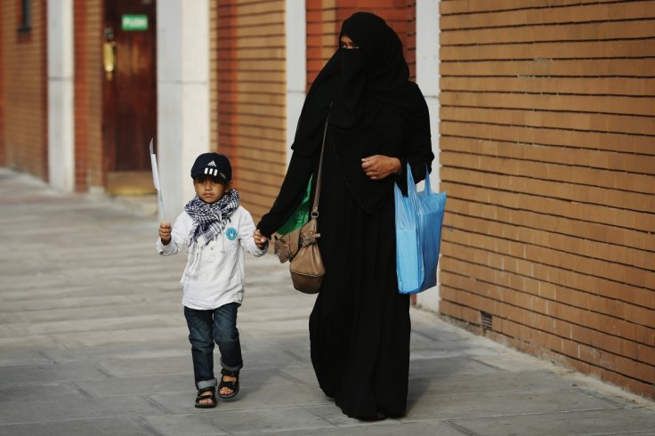 British Muslim woman and her child