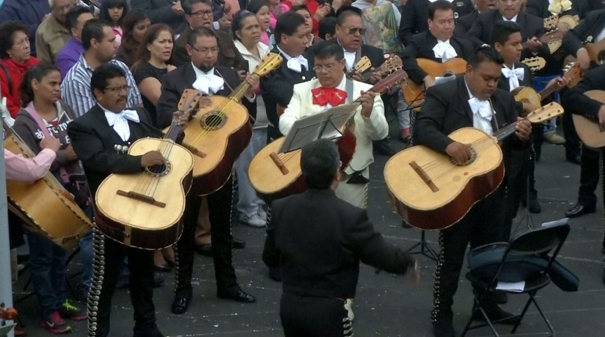 Mariachi musicians wearing their traditional garb