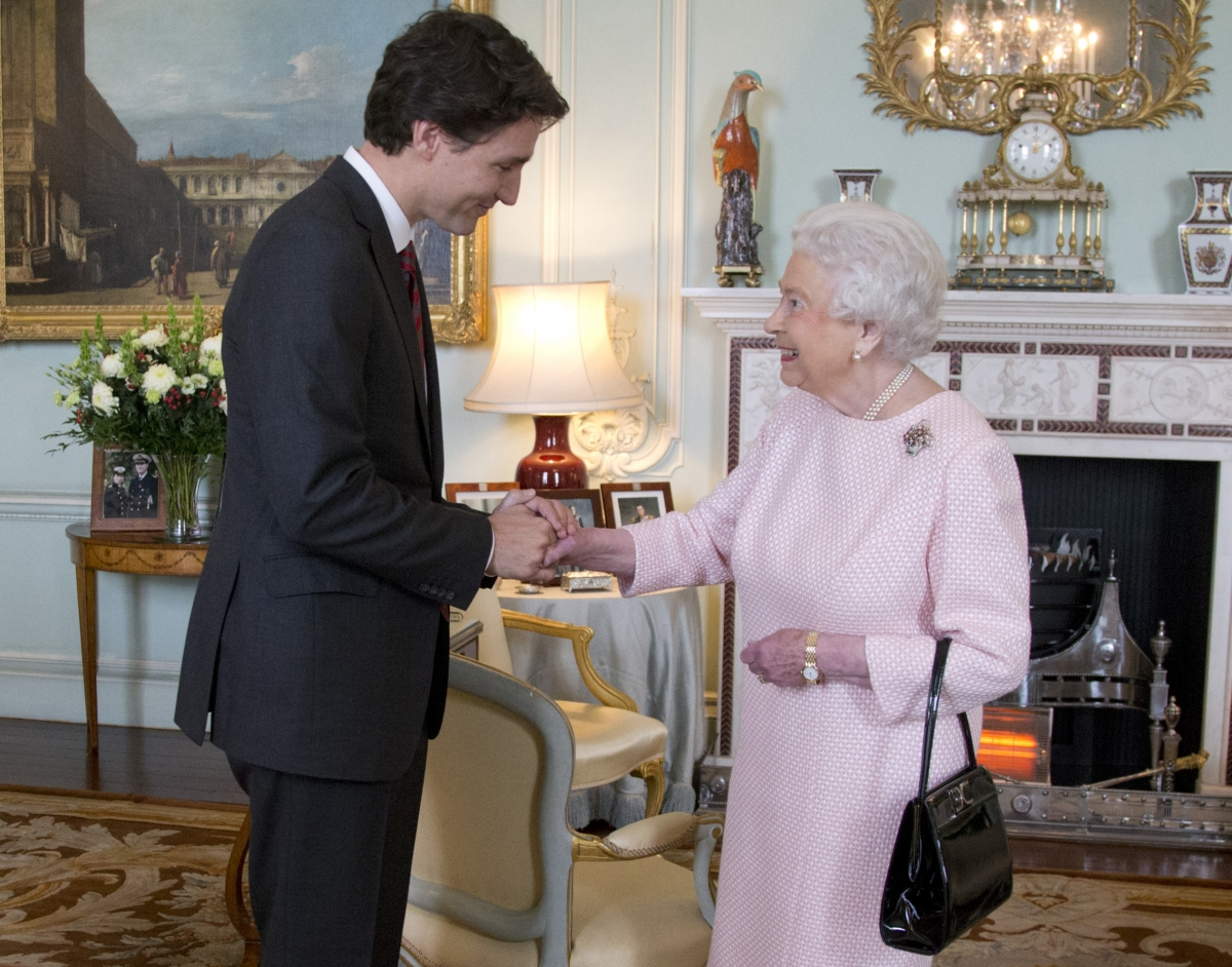 Justin Trudeau shakes hands with Queen Elizabeth II