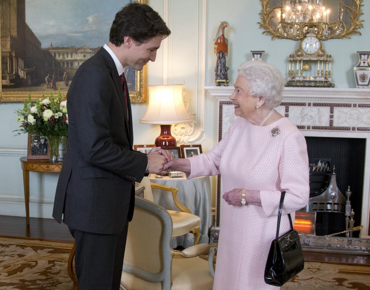 Justin Trudeau shakes hands with Queen Elizabeth II