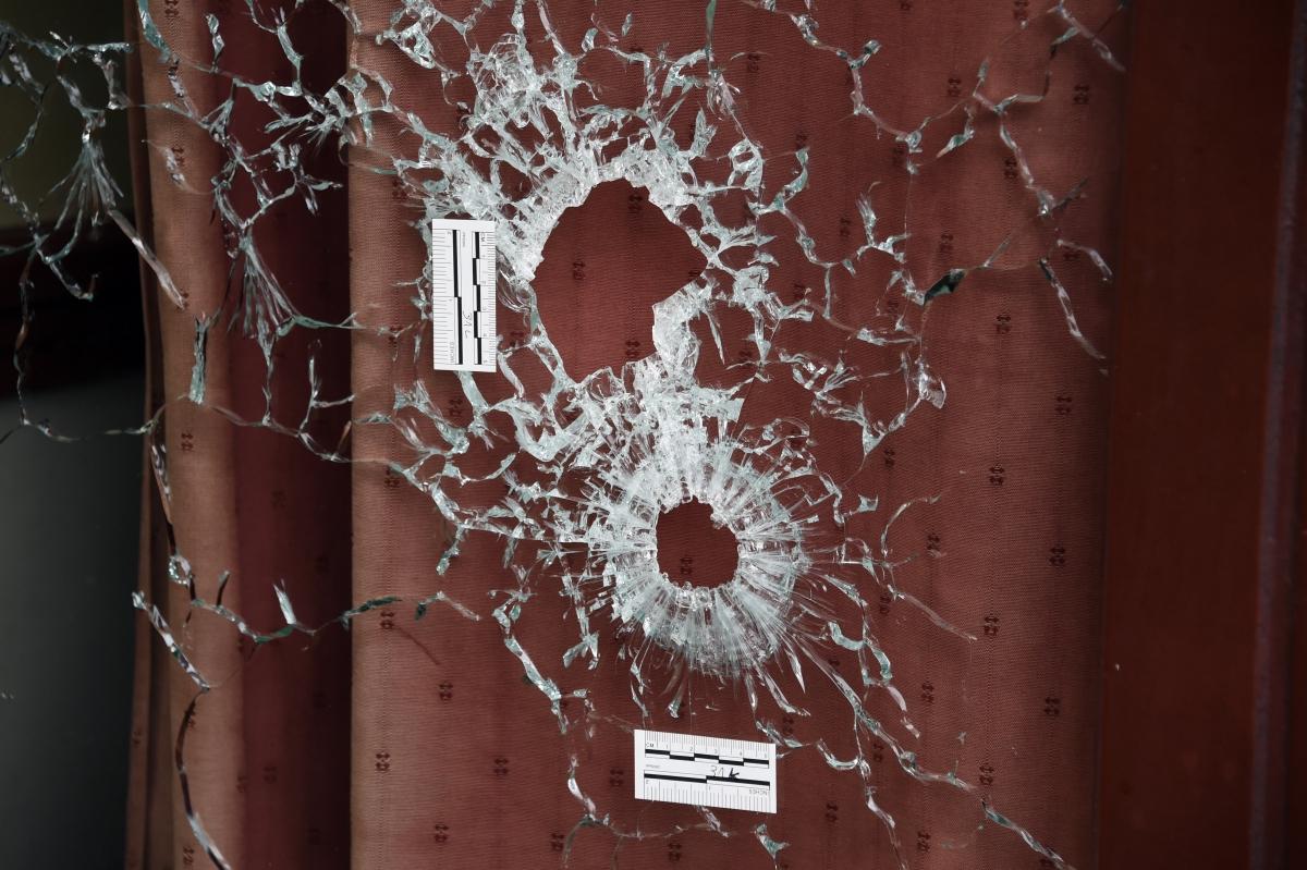 Bullet holes Paris window
