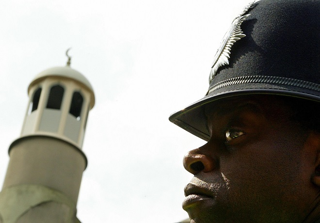 Policeman stands guard outside mosque in London