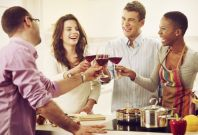 Four 30-year-olds drinking wine