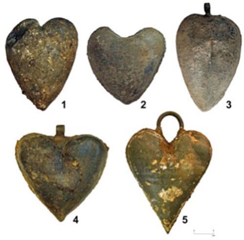 five heart-shaped lead urns