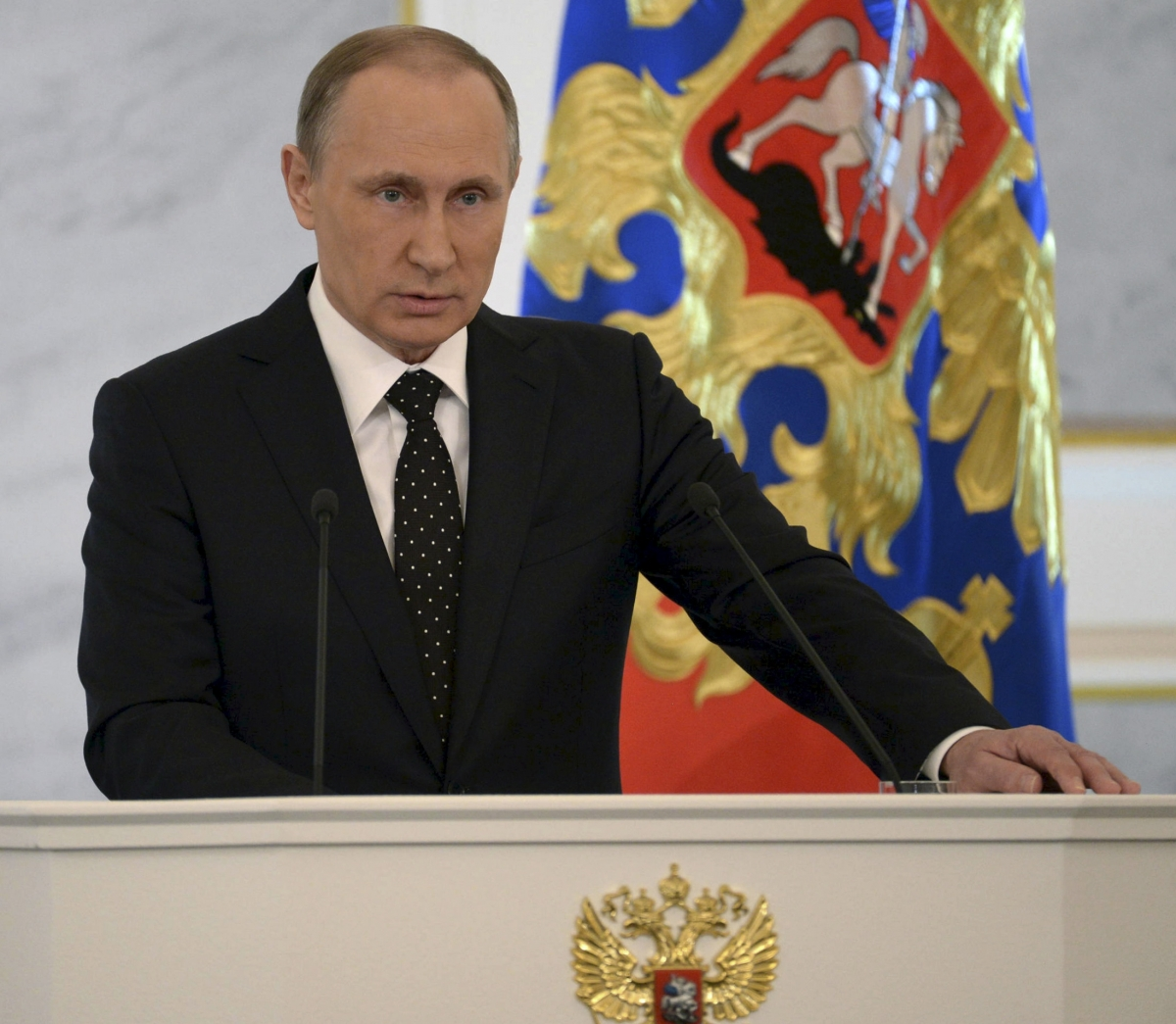 Russian President Vladimir Putin addresses the StateDuma