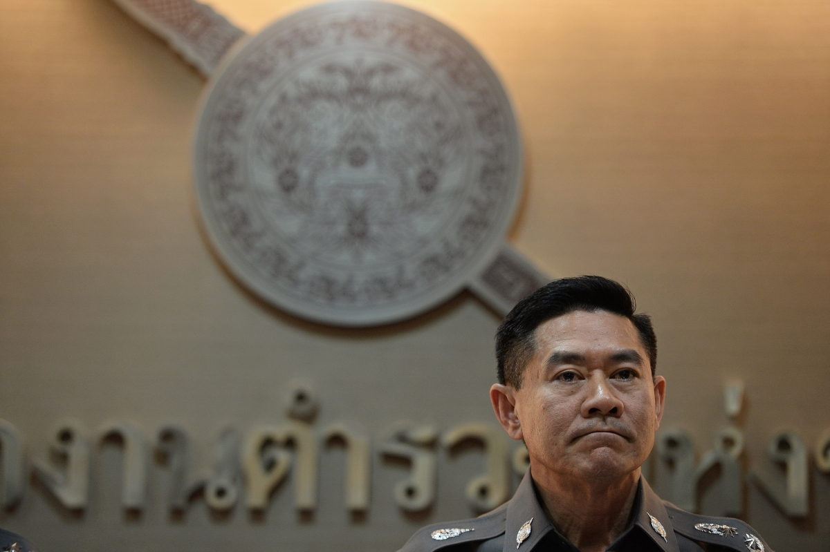 Thai deputy police spokesman Major General Songpol Wattanachai listens to a question during a press conference
