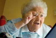 Grandma looks at TV screen