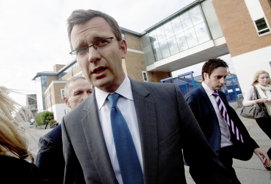 Andy Coulson, the former spokesman for Britain's Prime Minister David Cameron, leaves a police station after being bailed, in South London
