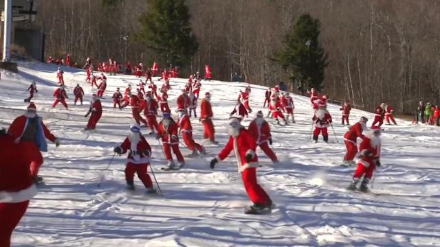 Santas skiing and snowboarding